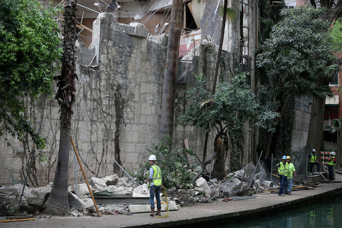 Clean up continues Thursday March 9, 2017 on the San Antonio River after debris fell into it after demolition was taking place yesterday at the former Solo Serve at 114 Soledad Street. Nobody was injured after the accident.
