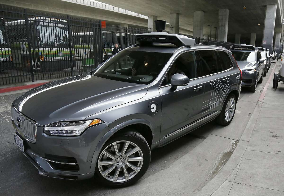 In this file photo, an Uber driverless car heads out for a test drive in San Francisco. Uber's self-driving cars are coming back to California, though the company doesn't plan to pick up passengers for now. The California Department of Motor Vehicles said Wednesday, March 8, 2017, it has granted the ride-hailing company permission to run two Volvo SUVs on public roads. (AP Photo/Eric Risberg, File)