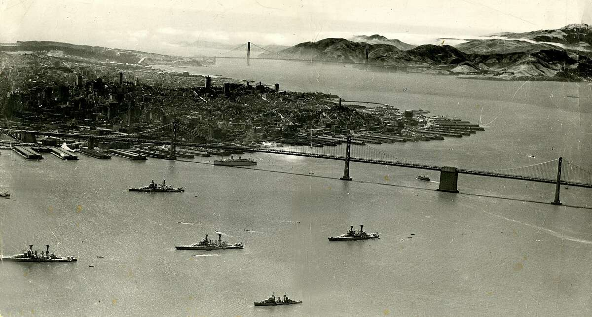 GALLERY: San Francisco aerial views then and now San Francisco aerial photograph showing the Oakland Bay Bridge and the Golden Gate Bridge, ca. 1940's.