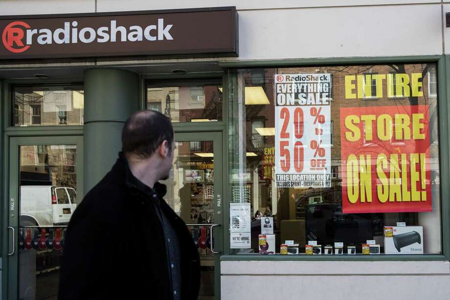 NEW YORK, NY - MARCH 9: A man walks past a RadioShack storefront in the West Village, March 9, 2017 in New York City. RadioShack has filed for bankruptcy for the second time in two years and will close about 200 of its remaining 1,500 stores. (Photo by Drew Angerer/Getty Images) Photo: Drew Angerer / Getty Images / 2017 Getty Images