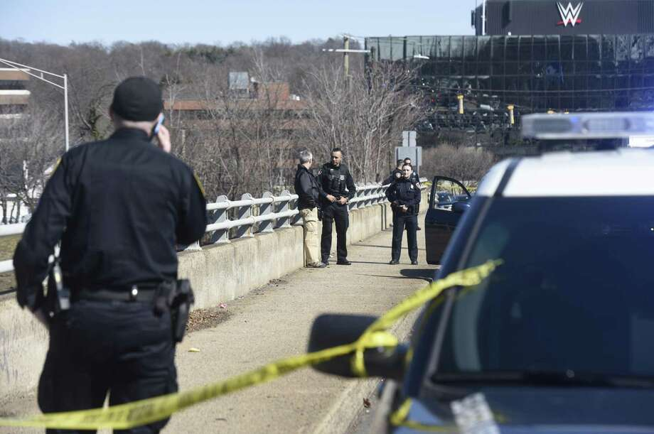 Police investigate the death of a woman who jumped off the East Main Street bridge onto Interstate 95 Thursday morning. Photo: Tyler Sizemore / Hearst Connecticut Media / Greenwich Time