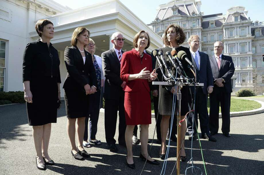 Dorothy A. Savarese, chairman of the American Bankers Association, flanked by other CEOs of small and community banks, speaks after a meeting Thursday with President Donald Trump at the White House. Photo: Olivier Douliery /Abaca Press / Abaca Press