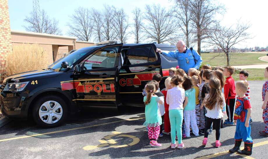 Officer Rick Thompson of the Edwardsville Police Department gave the kids a tour of one of the department's Ford Explorers. Students were able to turn on the sirens and speak over the intercom.