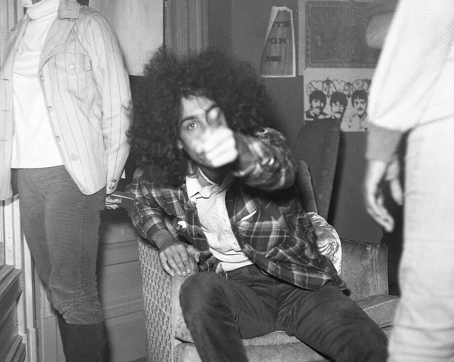 On Oct. 2, 1967, members of the Grateful Dead and friends were busted at their 710 Ashbury St. home by narcotics police. Band co-manager Danny Rifkin points at a Chronicle photographer from inside the home. Photo: Barney Peterson, The Chronicle