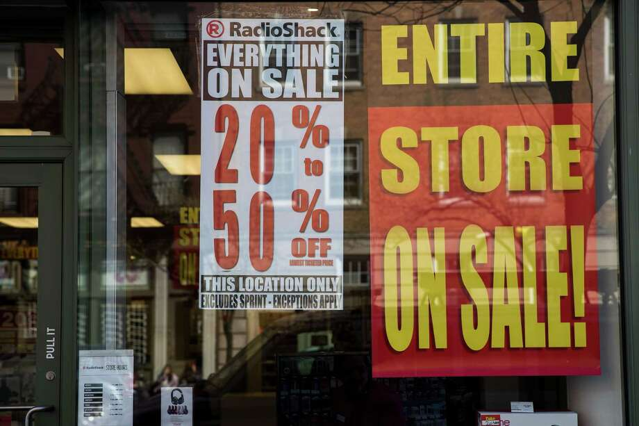Sale signs hang in the window of a RadioShack storefront in New York City. RadioShack has filed for bankruptcy for the second time in two years and will close about 200 of its remaining 1,500 stores. Photo: Drew Angerer /Getty Images / 2017 Getty Images