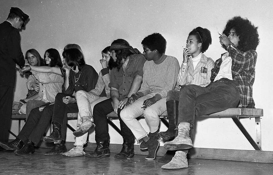 On Oct. 2, 1967, members of the Grateful Dead and their associates and friends are handcuffed together at the San Francisco Police Department headquarters. Photo: Barney Peterson, The Chronicle