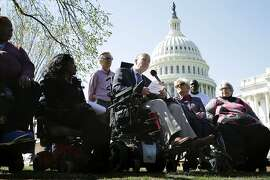 WASHINGTON, DC - MARCH 09:  Kent Keyser (C) talks about how the repeal of Obamacare would negatively impact him and other disable people during a news conference outside the U.S. Capitol March 9, 2017 in Washington, DC. Democratic and Independent senators urged Republicans to drop their healthcare legislation, saying it would disproportionally affect people with disabilities and women and small business owners.  (Photo by Chip Somodevilla/Getty Images)