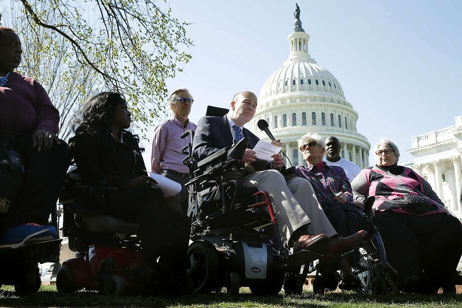 Kent Keyser (center) talks about how the repeal of the Affordable Care Act would negatively impact him and other disabled people during a news conference outside the U.S. Capitol. Photo: Chip Somodevilla, Getty Images