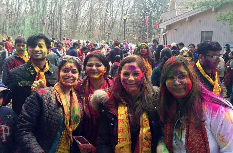 Attendees covered in colorful paint during Holi Festival 2016 at Wilton Hindu Temple, 68 Westport Road. Photo: Contributed Photo