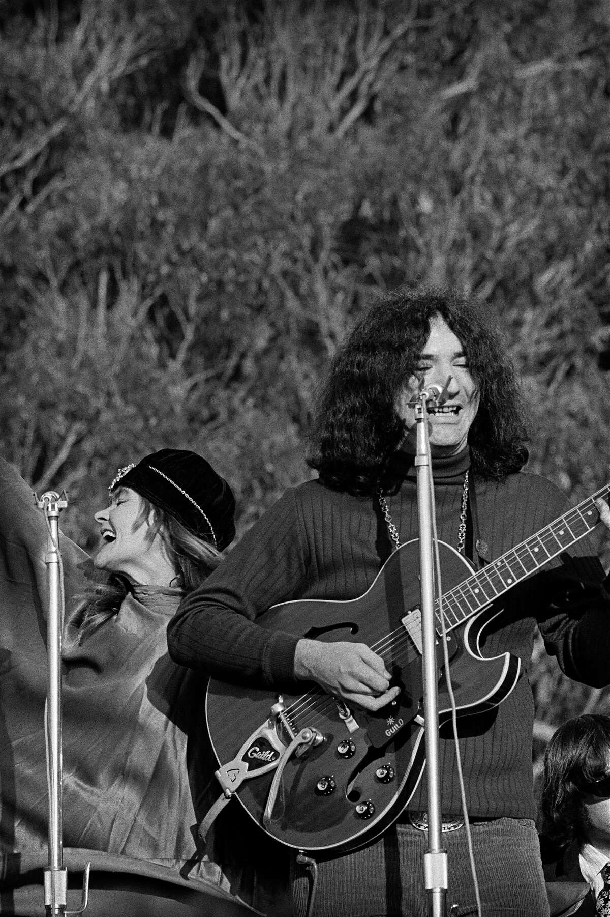 Jerry Garcia, right, and Donna Jean Godchaux of the Grateful Dead perform at the Human Be-In at the Polo Fields in Golden Gate Park in 1967.