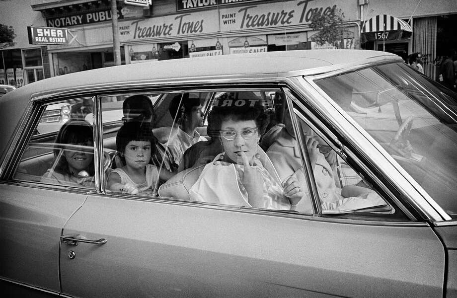 A family of tourists driving down Haight Street viewing the hippies in June 1967. Photo: © Jim Marshall Photography LLC
