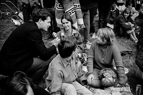 A reporter interviews concert goers during a Jefferson Airplane/Grateful Dead Concert in Golden Gate Park 1967