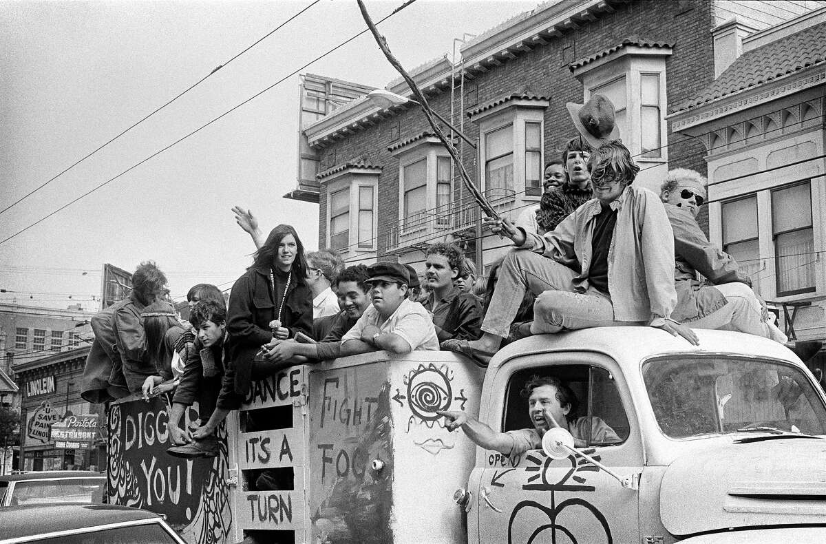Diggers driving through the Haight.