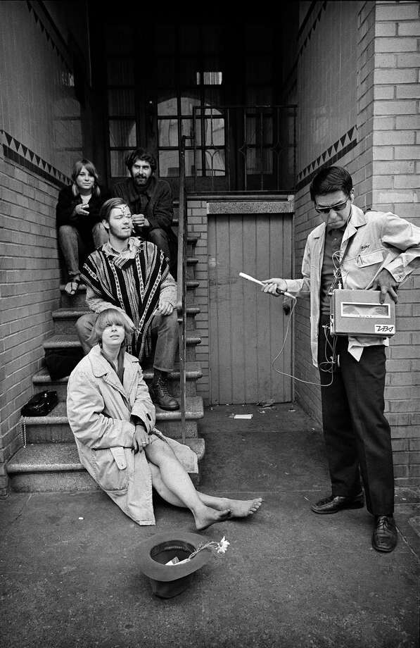 An unidentified reporter interviewing hippies in the Haight-Ashbury neighborhood. Photo: © Jim Marshall Photography LLC