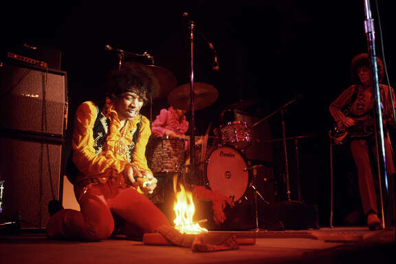 Jimi Hendrix lights his guitar on fire  at the Monterey Pop Festival on June 17, 1967.