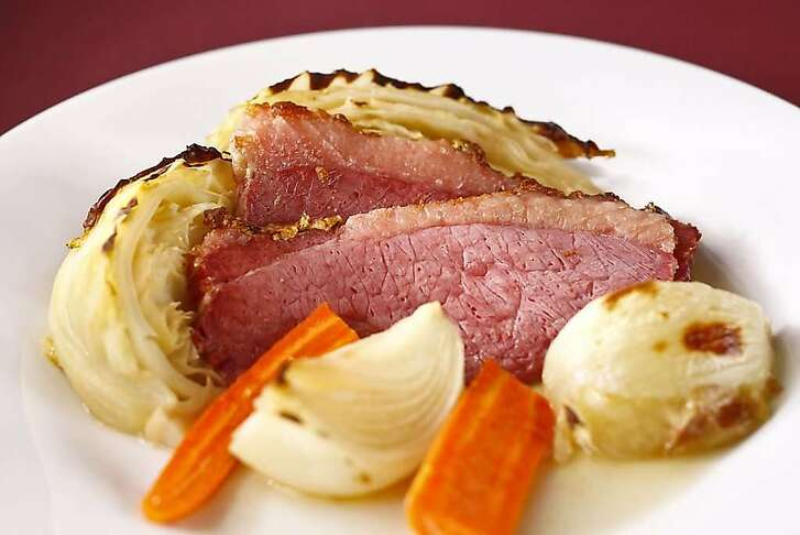 Roast Corned Beef With Cabbage, Onions & Carrots.