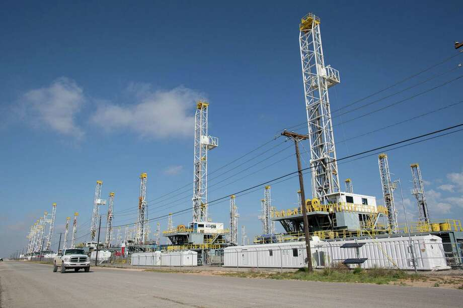 Drilling rigs stand idle outside of Odessa near West Texas' Permian Basin shale play. Oil prices have fallen by more than 5 percent in two days as drillers return more rigs to the field, helping boost U.S. oil stockpiles rose to record levels, according to data from the EIA. Photo: Associated Press /File Photo / Odessa American