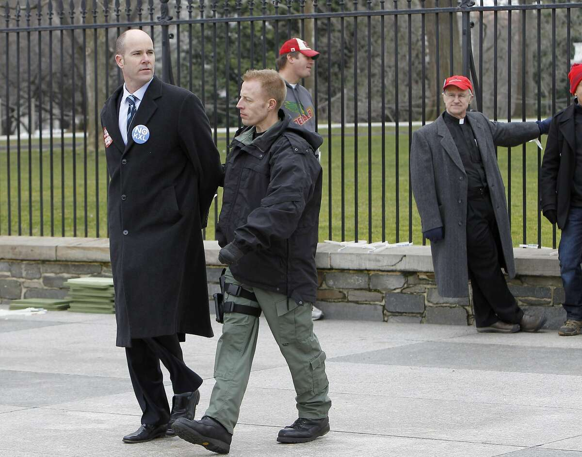 In this 2013 file photo, Sierra Club Executive Director Michael Brune (left) is arrested outside the White House in Washington, Wednesday, Feb. 13, 2013, as prominent environmental leaders tied themselves to the White House gate to protest the Keystone XL oil pipeline.