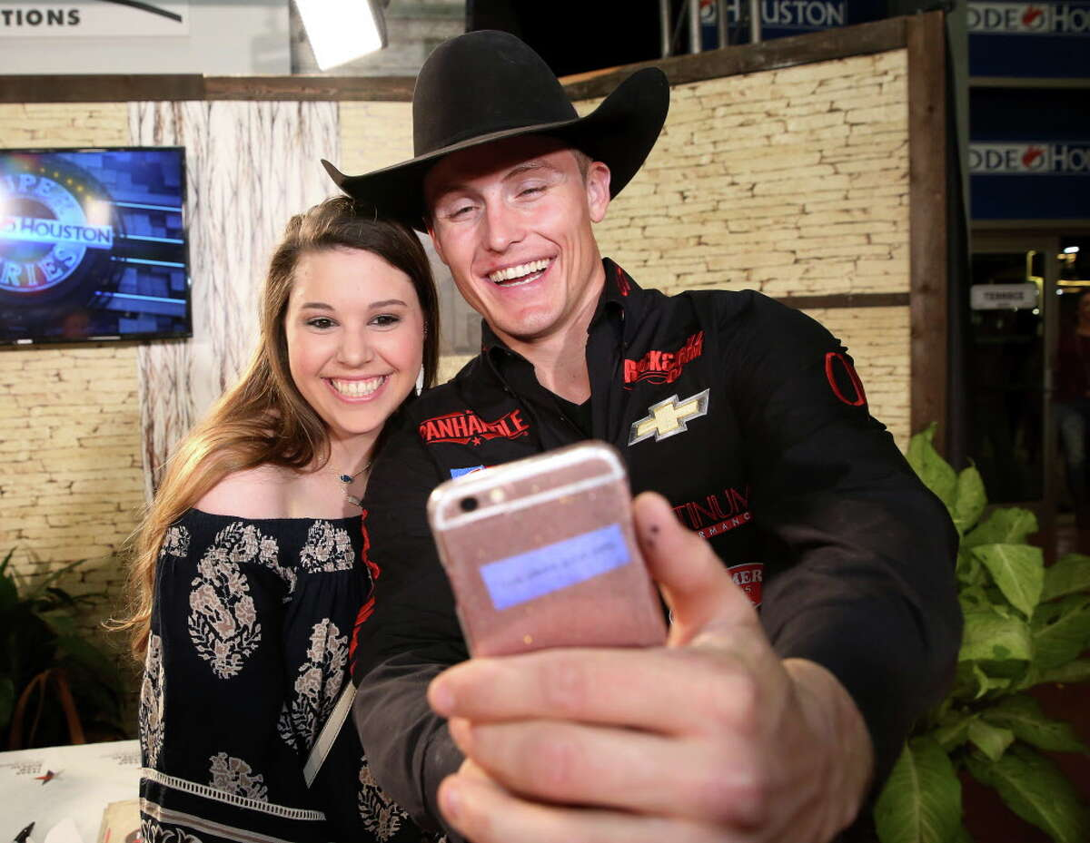 Tie-down roper Tuf Cooper does a selfie with his fan Jessica Robinson, 20, of Houston, at the fan zone after his Houston Livestock Show and Rodeo Super Series 1 Round 2 competition at NRG Stadium Wednesday, March 8, 2017, in Houston.