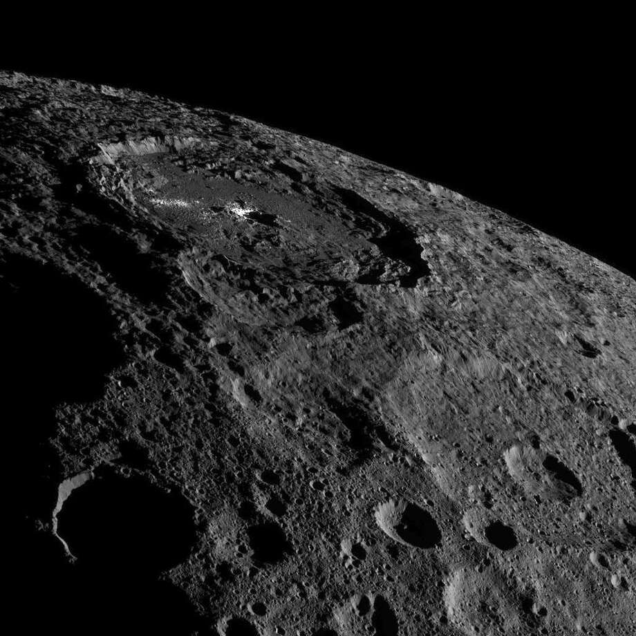 NASA caption: This image of the limb of dwarf planet Ceres shows a section of the northern hemisphere. Prominently featured is Occator Crater, home of Ceres' intriguing brightest areas. Dawn took this image on Oct. 17 from its second extended-mission science orbit (XMO2), at a distance of about 920 miles (1,480 kilometers) above the surface. Photo: NASA/JPL-Caltech/UCLA/MPS/DLR/IDA