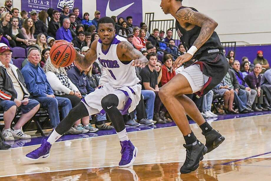 S.F. State guard Warren Jackson (left) leads the Gators in scoring and earned first-team all-conference honors this year. Photo: SF State Athletics/Michael Urakami