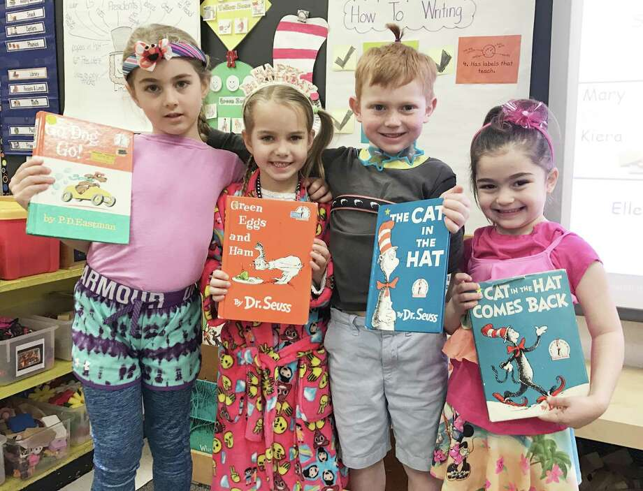 Ox Ridge kindergartners Mackenzie Struk, left, Alice Miller, Colton Stafford and Alexa Mitrione show off their wacky clothes in honor of Dr. Seuss's birthday. Photo: Contributed Photo
