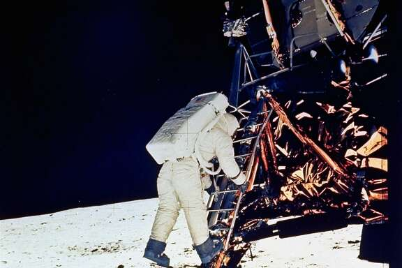 **ADVANCE FOR THURSDAY, JULY 16**  FILE - In this July 20, 1969 file photo,  Astronaut Edwin E. Aldrin, Jr., lunar module pilot, descends steps of Lunar Module ladder as he prepares to walk on the moon.  He had just egressed the Lunar Module.  (AP Photo/NASA, file)