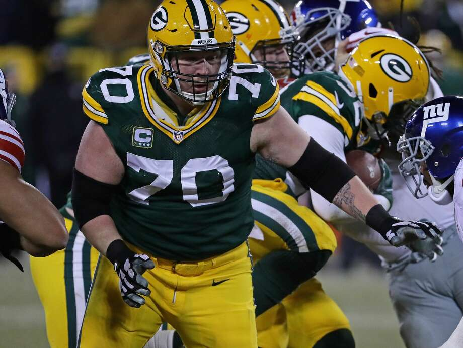 T.J. Lang #70 of the Green Bay Packers moves to block against the New York Giants at Lambeau Field on January 8, 2017 in Green Bay, Wisconsin. (Photo by Jonathan Daniel/Getty Images) Photo: Jonathan Daniel/Getty Images