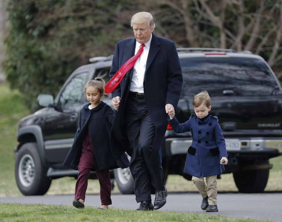 President Donald Trump walks with his grandchildren Arabella Kushner and Joseph Kushner across the South Lawn of the White House. The president continues to generate a heavy volume of letters from both defenders and detractors. Photo: Pablo Martinez Monsivais /Associated Press / AP