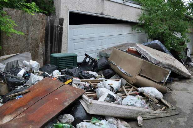 Trash piles up in Camelot II, an unincorporated portion of Bexar County that is surrounded by San Antonio and the city of Windcrest in 2015. A city/county deal put an end to such scenes, but state legislation that would affect other Bexar unincorporated areas is still needed.