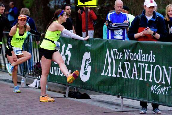 Runners warm up before taking part in The Woodlands Marathon Saturday, March 4, 2017, in The Woodlands.