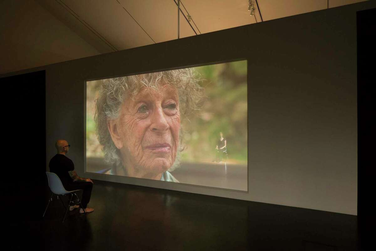 Rope Dance, 2015. Concept, title and score by Anna Halprin (shown on screen). Interpretations and variations by Janine Antoni, seated at right, and Stephen Petronio, at left. Commissioned by The Fabric Workshop and Museum, Philadelphia. Rope Dance performance part of Entangle at the Tang Teaching Museum at Skidmore College. Photograph by Arthur Evans.