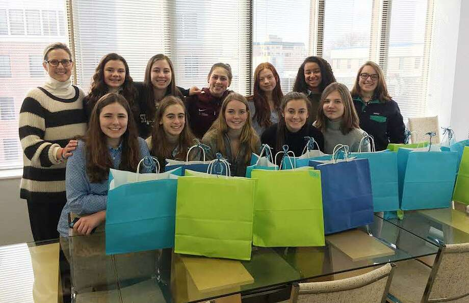 Students from St. Luke's School in New Canaan and their advisor Janet Jochem show off the bags filled with clothing to be donated to The Center for Sexual Assault Crisis Counseling and Education in Stamford. Photo: Contributed Photo / Contributed Photo / New Canaan News