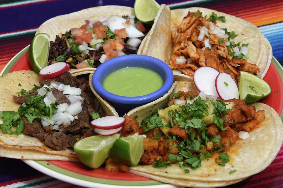 Taco sampler plate at Viva Cinco de Mayo on Tuesday, Feb. 7, 2017 in Albany, N.Y. Clockwise from top left, chapulines, pollo chipotle, al pastor (marinated pork, pineapple and onion) and steak. (Lori Van Buren / Times Union) Photo: Lori Van Buren / 20039883A