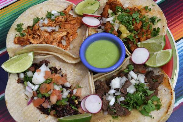Taco sampler plate at Viva Cinco de Mayo on Tuesday, Feb. 7, 2017 in Albany, N.Y. Clockwise from bottom left, chapulines, pollo chipotle, al pastor (marinated pork, pineapple and onion) and steak. (Lori Van Buren / Times Union)