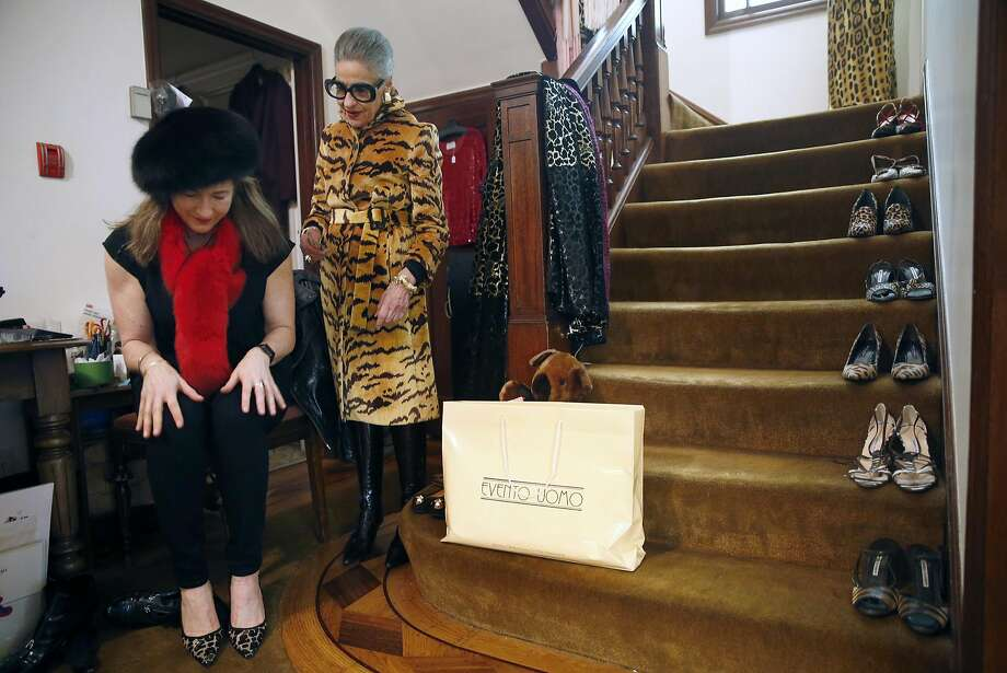 Joy Bianchi watches Hanna Levitz try on a pair of shoes at Helpers House of Couture in San Francisco. Photo: Scott Strazzante, The Chronicle