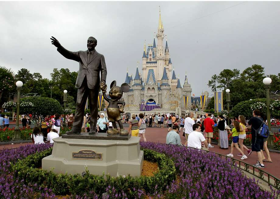 In this Tuesday, June 5, 2012, file photo, visitors stroll along Main Street at Walt Disney World, in Lake Buena Vista, Fla. Photo: John Raoux, Associated Press