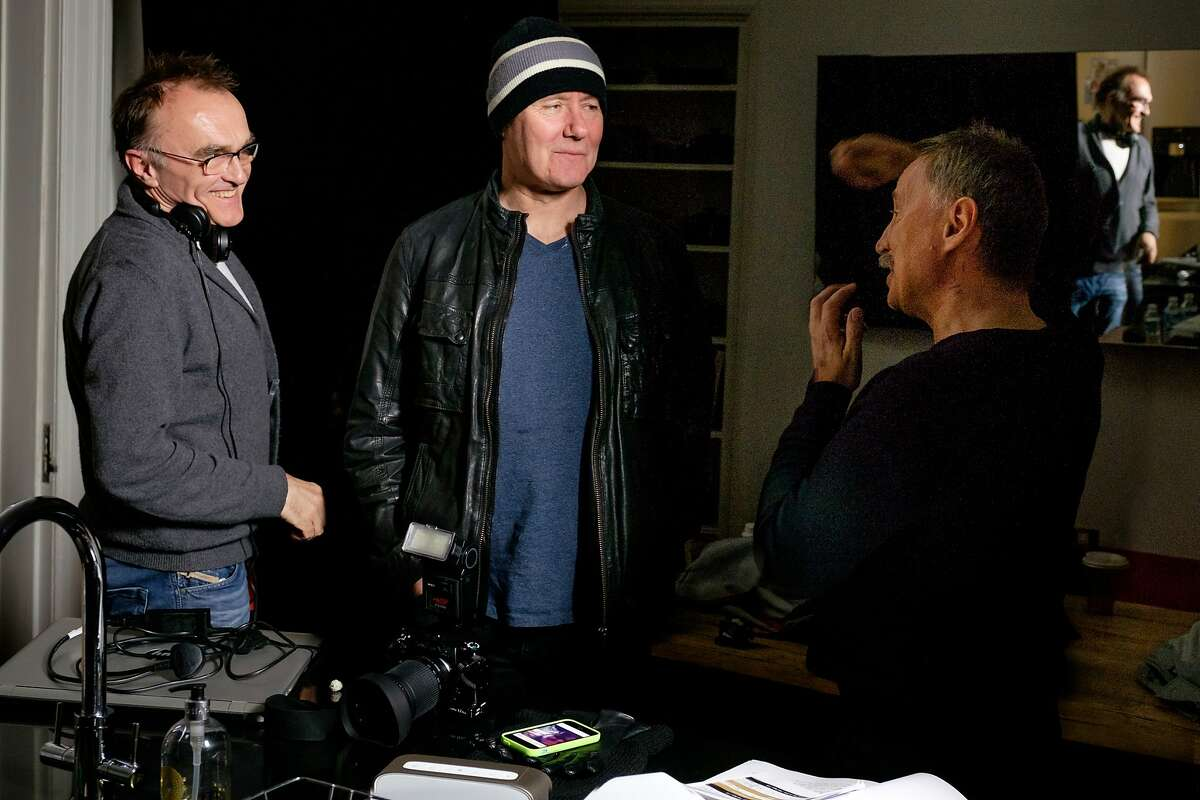 L-R: Danny Boyle directs Irvine Welsh and Robert Carlyle in a scene from