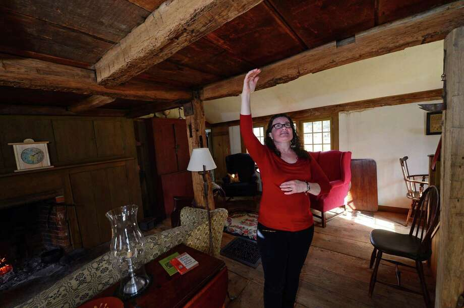Elaine McCarthy gives a tour of her meticulously restored 1700s-era home on March 3, which is filled with period pieces and items found during the renovations of the house on Newtown Avenue in Norwalk. Photo: Erik Trautmann / Hearst Connecticut Media / Norwalk Hour