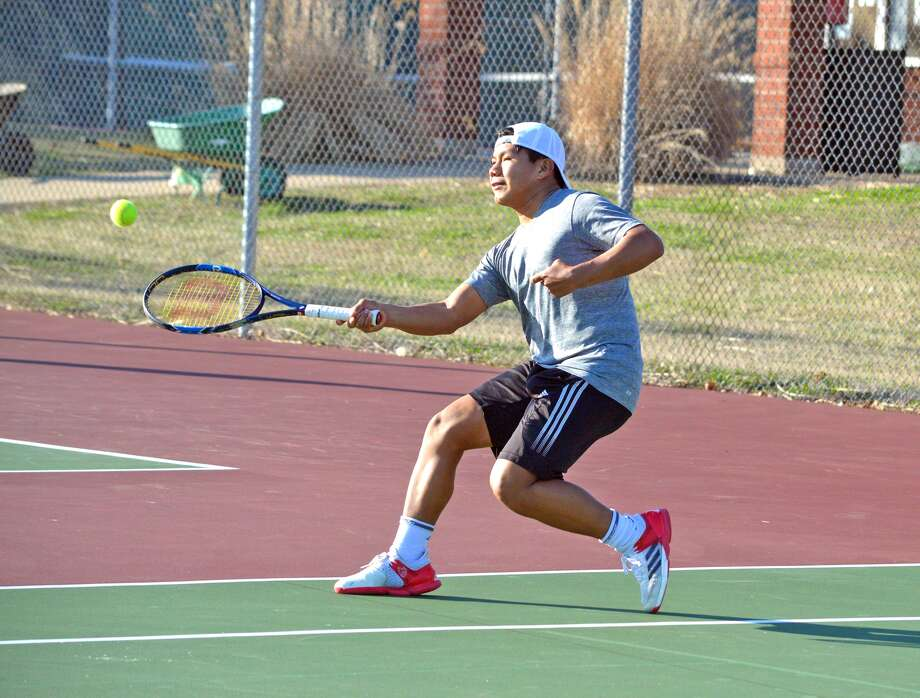 Edwardsville sophomore Zach Trimpe hits a shot during practice last week for the boys' tennis team. Trimpe spent the fall semester in Florida.