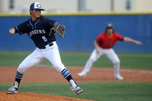 Greenwood pitcher Josh Reyes (8) winds up against Slaton on Thursday, March 9, 2017, at Greenwood High School.  James Durbin/Reporter-Telegram