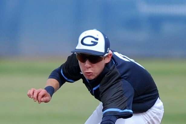 Greenwood's Kason Buffaloe goes after a hit from Slaton on Thursday, March 9, 2017, at Greenwood High School.  James Durbin/Reporter-Telegram