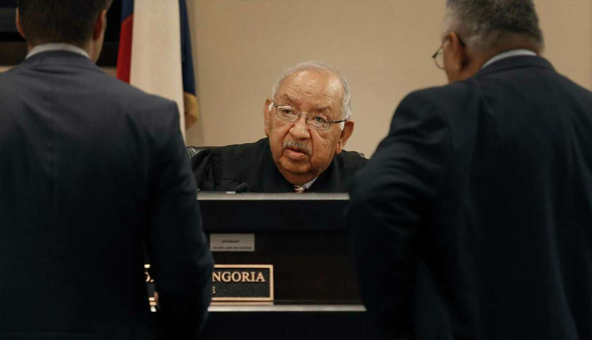 County Court No. 5 Judge John Longoria (center) presides in his courtroom on Thursday, Mar. 9, 2017. A man here illegally, but who applied for a green card through his wife, was arrested this week outside a Bexar County courtroom after he left a pretrial conference in his DWI case. The arrest of Nicholas Lugo set off a debate on whether there has been a shift in practice targeting immigrants for deportation by the Trump administration. Longoria said Lugo's arrest at the courthouse is unusual and might have a chilling effect on other undocumented immigrants who may have cases pending in the county courts.