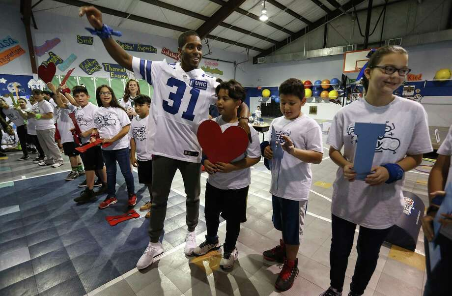 Dallas Cowboys safety Byron Jones joins students at Vestal Elementary School for an event to promote a healthier lifestyle. Photo: Kin Man Hui /San Antonio Express-News / ©2017 San Antonio Express-News