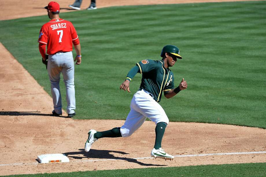 MESA, AZ - MARCH 09:  Khris Davis #2 of the Oakland Athletics rounds third base to score against the Cincinnati Reds in the third inning of the spring training game at HoHoKam Stadium on March 9, 2017 in Mesa, Arizona.  (Photo by Jennifer Stewart/Getty Images) Photo: Jennifer Stewart, Getty Images