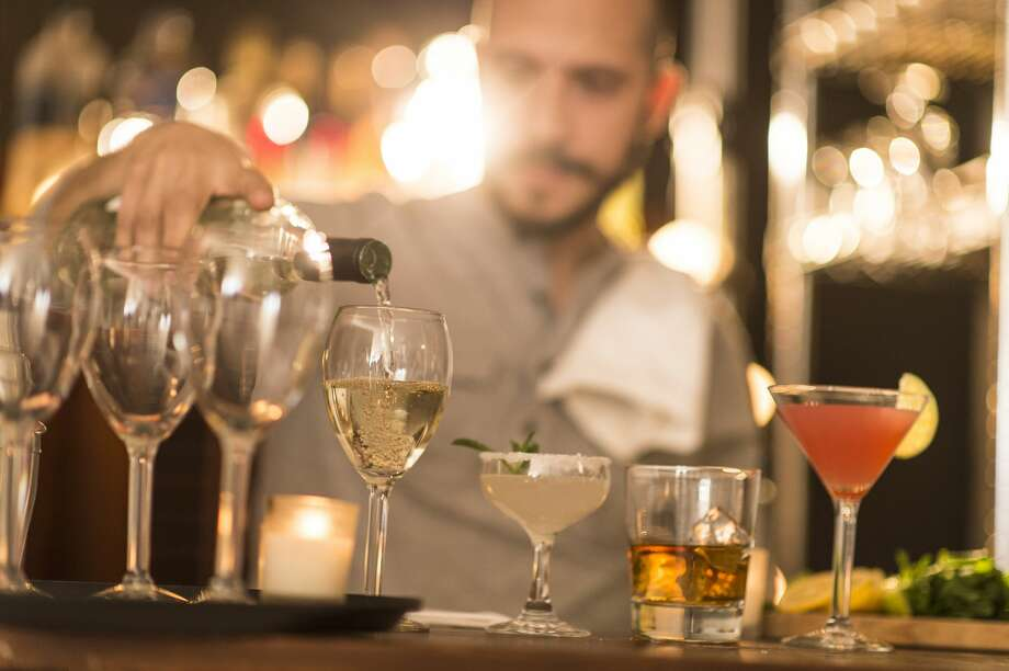 Click ahead to see the nine things you're doing wrong at cocktail bars.  Photo: JGI/Tom Grill/Getty Images/Blend Images