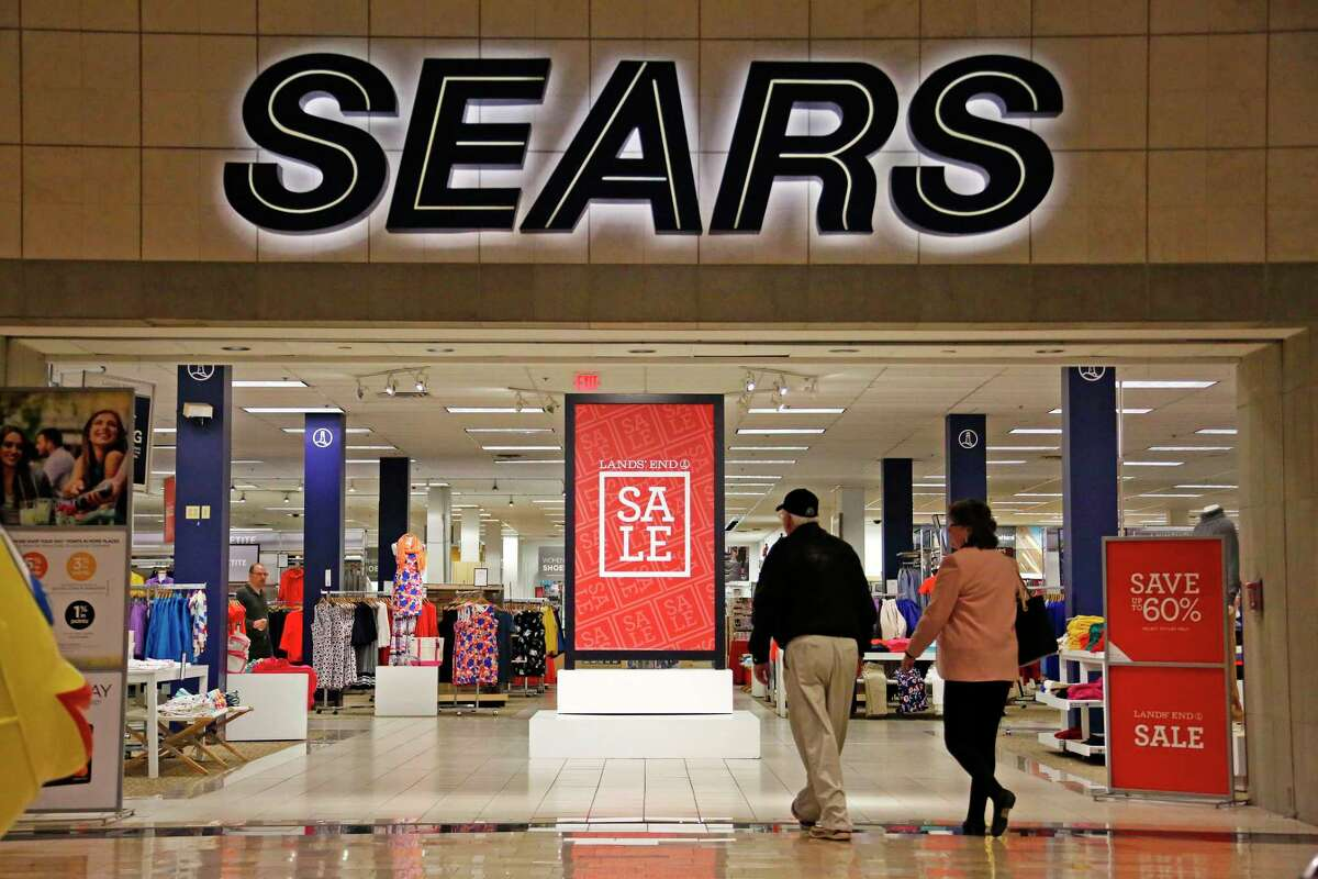 FILE - In this Wednesday, Feb. 8, 2017, file photo, shoppers walk into a Sears store in Pittsburgh. Sears Holdings Corp. on Thursday, March 9, 2017, reported a loss of $607 million in its fiscal fourth quarter. (AP Photo/Gene J. Puskar, File) ORG XMIT: NYAG401