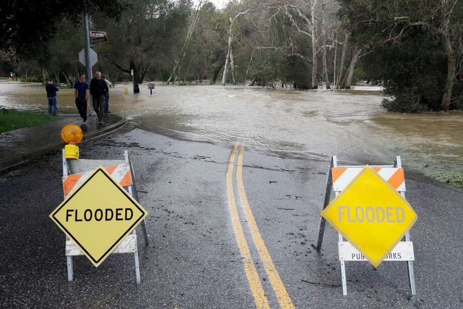 The overflowing waters of Coyote Creek caused road flooding in Morgan Hill recently. Winter rains have saturated once-drought stricken California but have created chaos for residents hit hard by the storms.