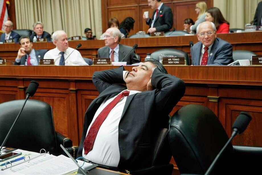 """House Rep. Tony Cardenas, D-Calif., stretches during a house  committee meeting in 2017. Cardenas felt he was verbally attacked by a congressman yelling """"Go back to Puerto Rico."""" Photo: J. Scott Applewhite, STF / AP"""