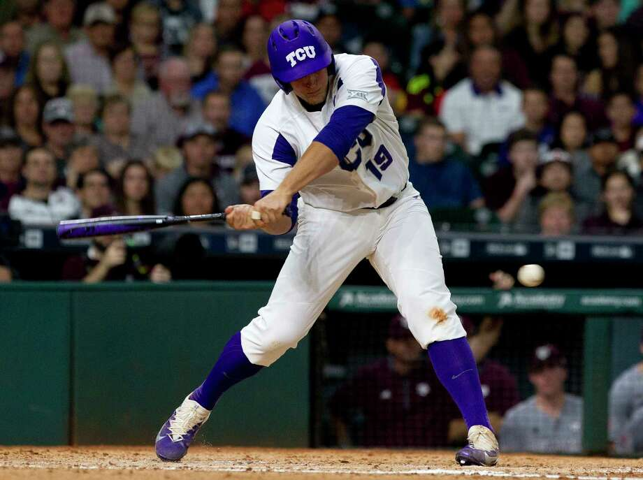 TCU's Luken Baker, former Oak Ridge High School player, hits an RBI single off Texas A&M starting pitcher Stephen Kolek during the first inning of a Houston College Classic baseball game against Texas A&M at Minute Maid Park Saturday, March 4, 2017, in Houston. Photo: Jason Fochtman, Staff Photographer / © 2017 Houston Chronicle